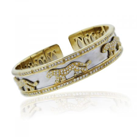 You are viewing this 18k Two Tone Gold and Diamond Panther Design Bangle Bracelet!