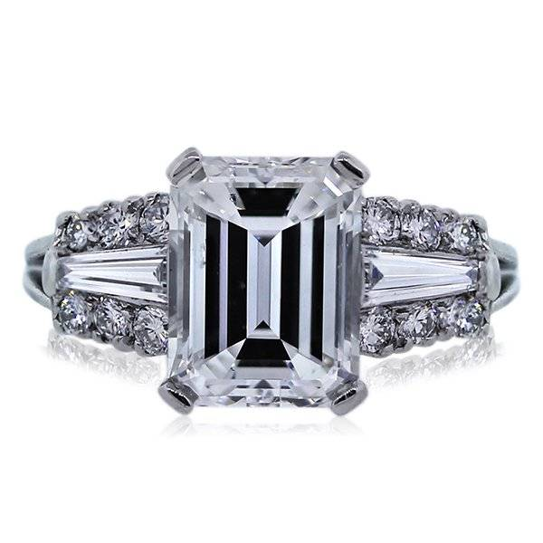 Emerald Cut Halo Engagement ring with baguettes