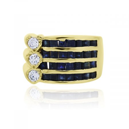 You are viewing this 14k Yellow Gold Diamond Four Row Sapphire Cocktail Ring!