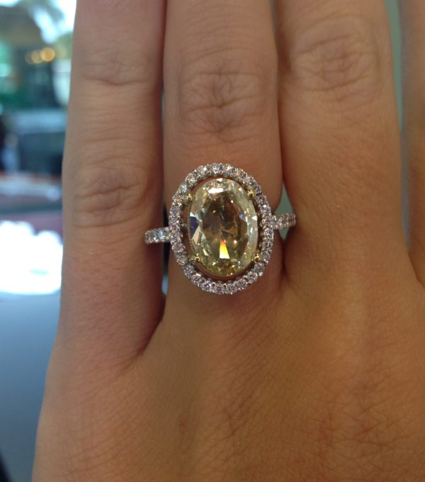 wearing 18k Two Tone Gold Fancy Yellow Oval Rose Cut Micro Pave Diamond Ring