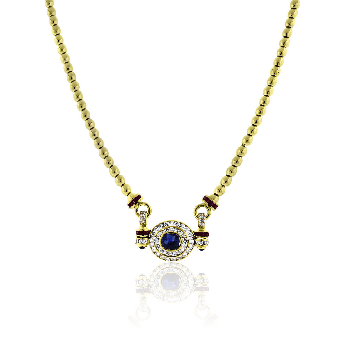 You are viewing this 18k Yellow Gold Blue Sapphire Diamond Ruby Necklace!