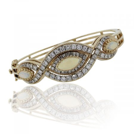 You are viewing this 14k Yellow Gold Diamond Opal Bangle Bracelet!