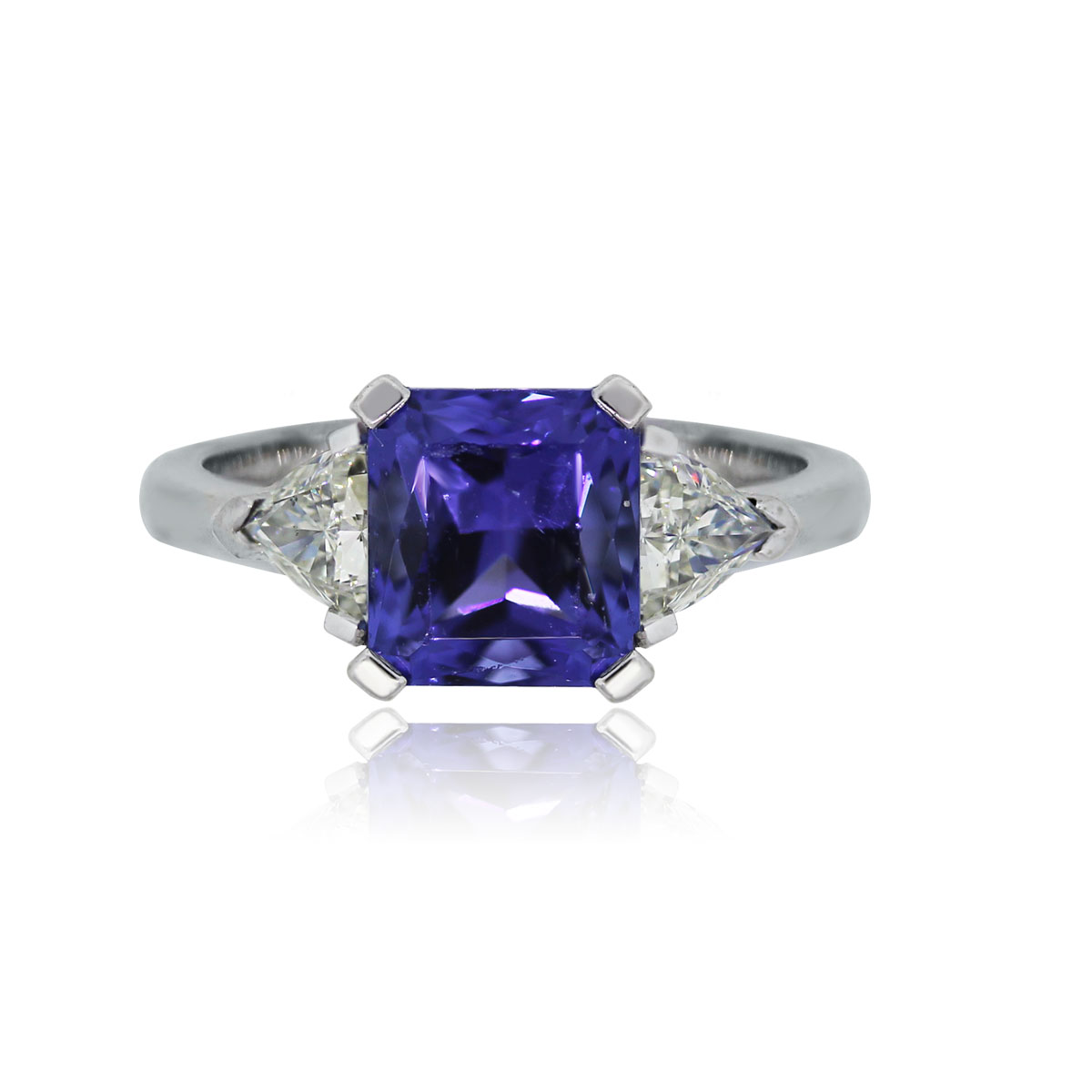 You are viewing this 18k White Gold Tanzanite Trillion Diamond Ring!