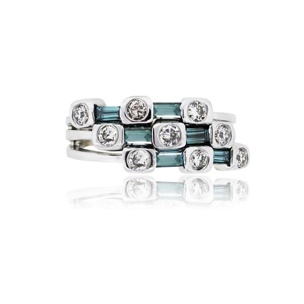 You are viewing this 14k White Gold Irradiated Blue Diamonds Ring!