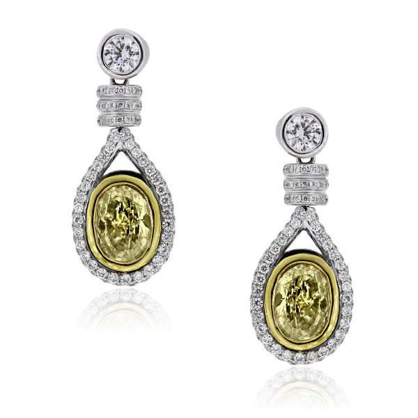 You are viewing these 18k Two Tone Oval Brilliant 3.03ct Fancy Yellow EGL Cert. Earrings!