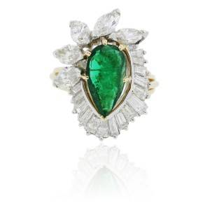 Emerald platinum and gold and diamond ring