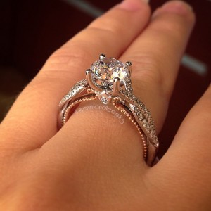 White gold and rose gold diamond solitaire with twisted sides