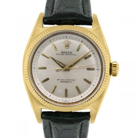 You are viewing this Rolex Oyster Perpetual 6502 18k Yellow Gold On Leather Band Watch!