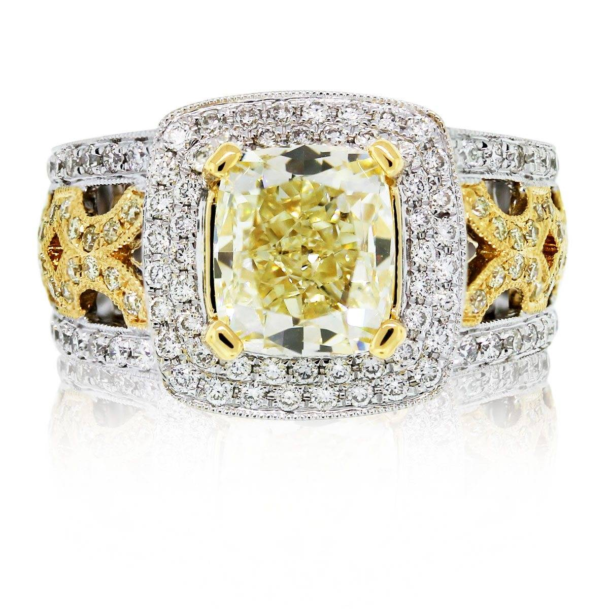 Cushion cut fancy yellow engagement ring