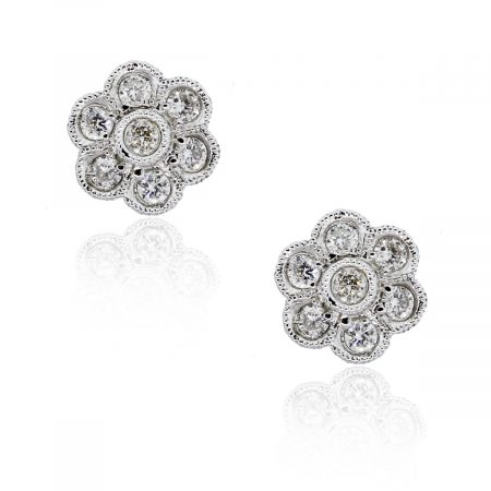 You are viewing this 18K White Gold .28ctw Diamond Flower Stud Earrings!
