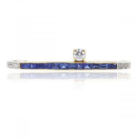You are viewing this 14k Yellow Gold Blue Sapphire and Diamond Bar Pin!