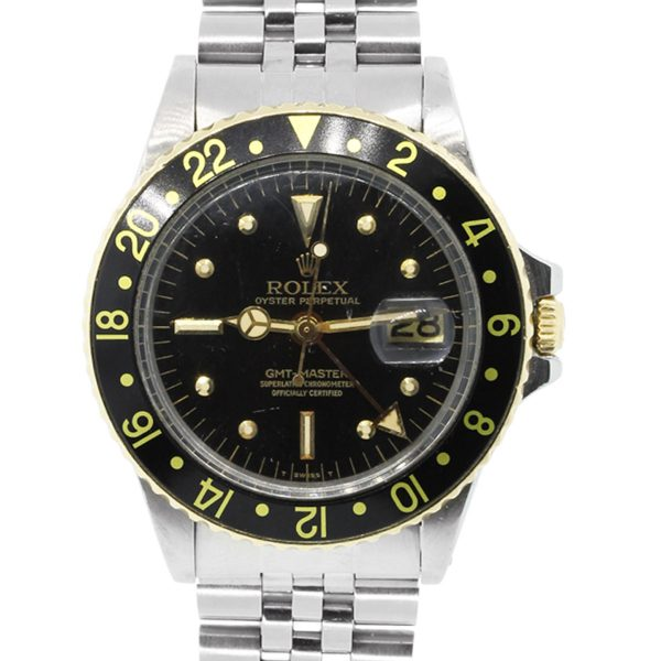 You are viewing this Rolex 1675 GMT Master Two Tone Black Dial Watch!