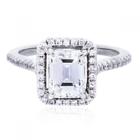 You are viewing this 18k White Gold GIA 1.61ct Emerald Cut Diamond Halo Ring!