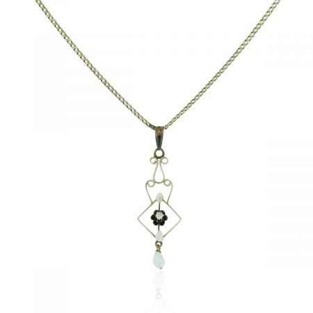 You are viewing this 14k Yellow Gold .04ctw Diamond Pearl Vintage Necklace!