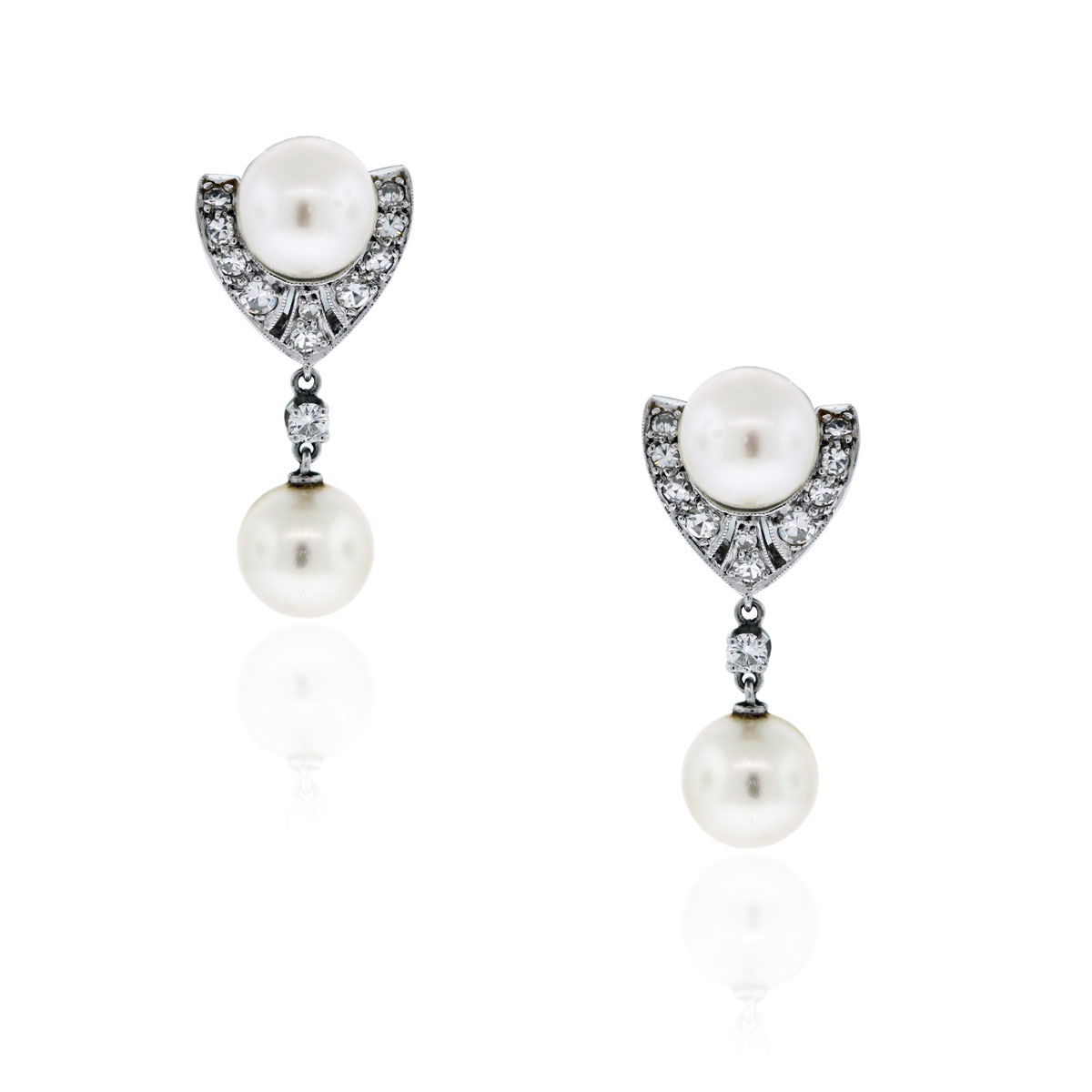 You are viewing this 14k White Gold .60ctw Diamond & Pearl Dangle Earrings!