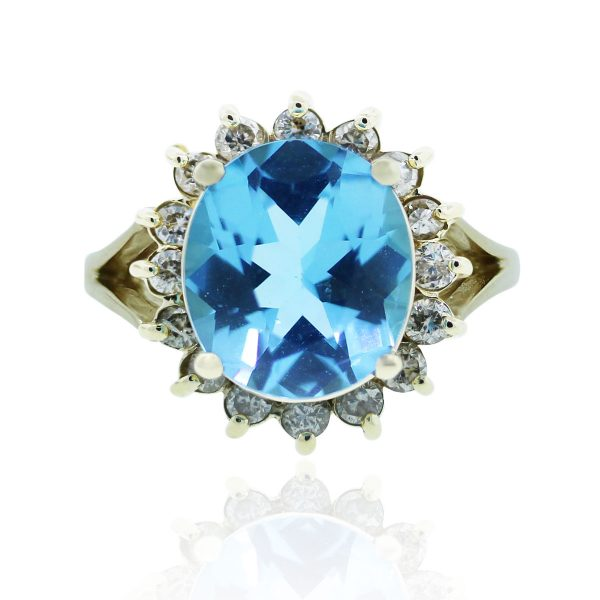 You are viewing this 14k Yellow Gold Blue Topaz 0.32ctw Diamond Cocktail Ring