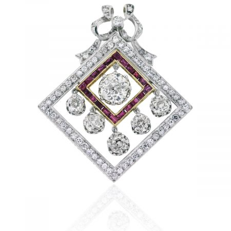 You are viewing this 18k Two Tone 3.8ctw Diamond & Ruby Vintage Pendant !