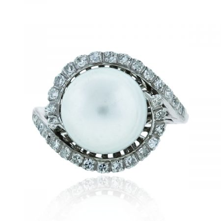 You are viewing this 14k White Gold .65ctw Diamonds & 11mm Pearl Ring!