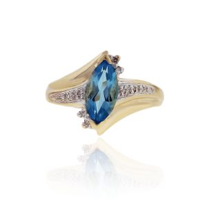 You are viewing this 10k Yellow Gold Marquise Blue Topaz Diamond Ring!