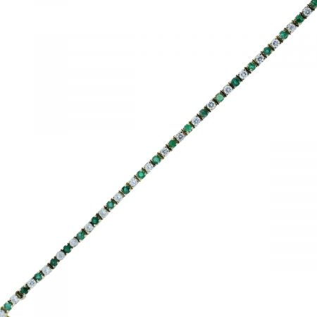 You are viewing this 14k Yellow Gold Diamond & Emerald 4.4ctw Tennis Bracelet!