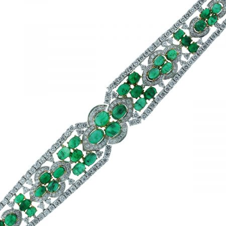 You are viewing this 18k Two Tone 32.25ctw of Diamonds and Emeralds Bracelet!
