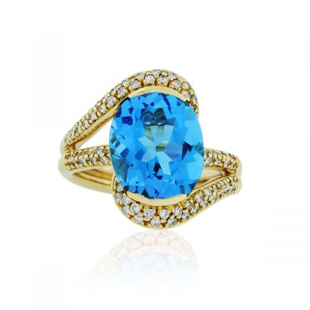 You are viewing this 18K Yellow Gold Oval Blue Topaz & Diamond Ring