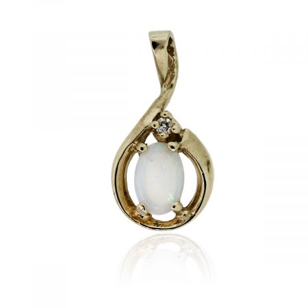 You are viewing this 14k Yellow Gold Opal & .02ctw Diamond Pendant