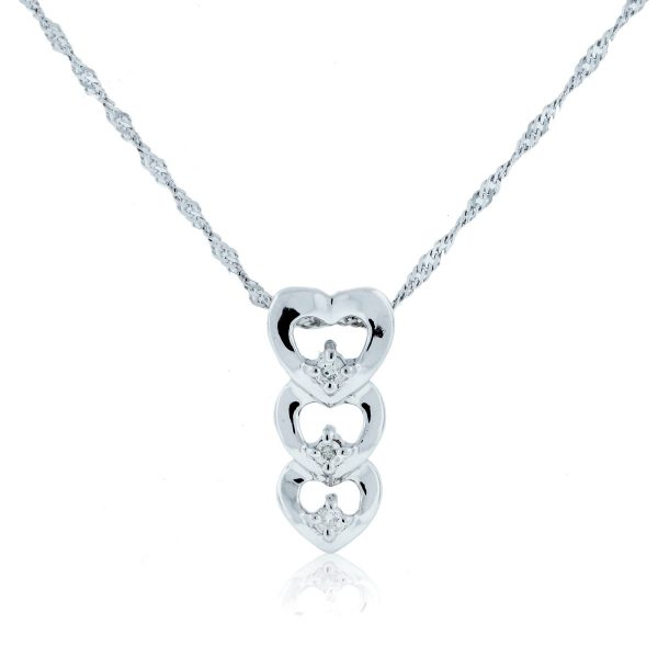 You are viewing this 10K White Gold .10ctw Diamond Triple Heart Pendant