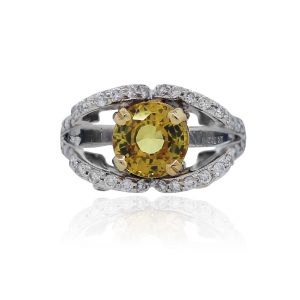 You are viewing this 18k White Gold Yellow Sapphire .60ctw Diamond Ring!