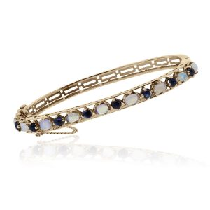 You are viewing this 14k Rose Gold Cabochon Opal & Blue Stone Bangle!