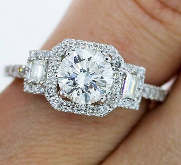 3 stone halo engagement ring that's totally unique