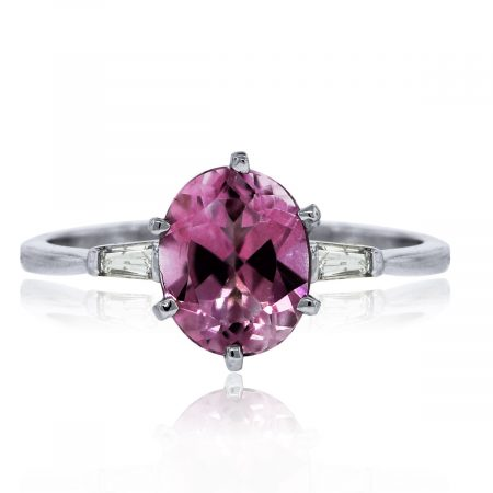 You are viewing this 14k White Gold Pink Quartz Baguette Diamond Accent Ring!