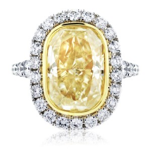 Fancy yellow oval diamond engagement ring