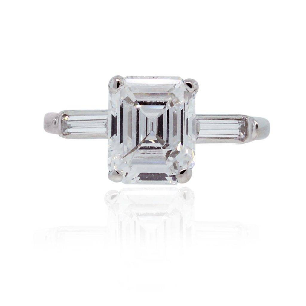 Platinum emerald cut engagement ring with baguettes