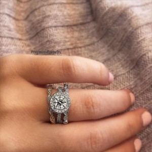 Halo engagement ring with two wedding rings