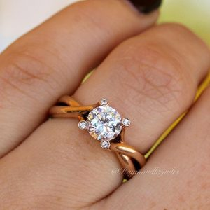Rose gold twisted solitaire engagement ring