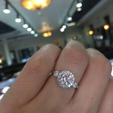 Three stone halo engagement ring by Gabriel & Co. New York