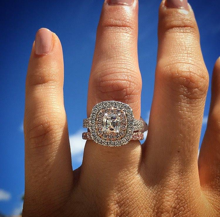 Rose gold halo engagement ring with cushion cut diamond