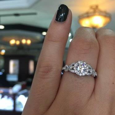 A perfect love knot halo engagement ring