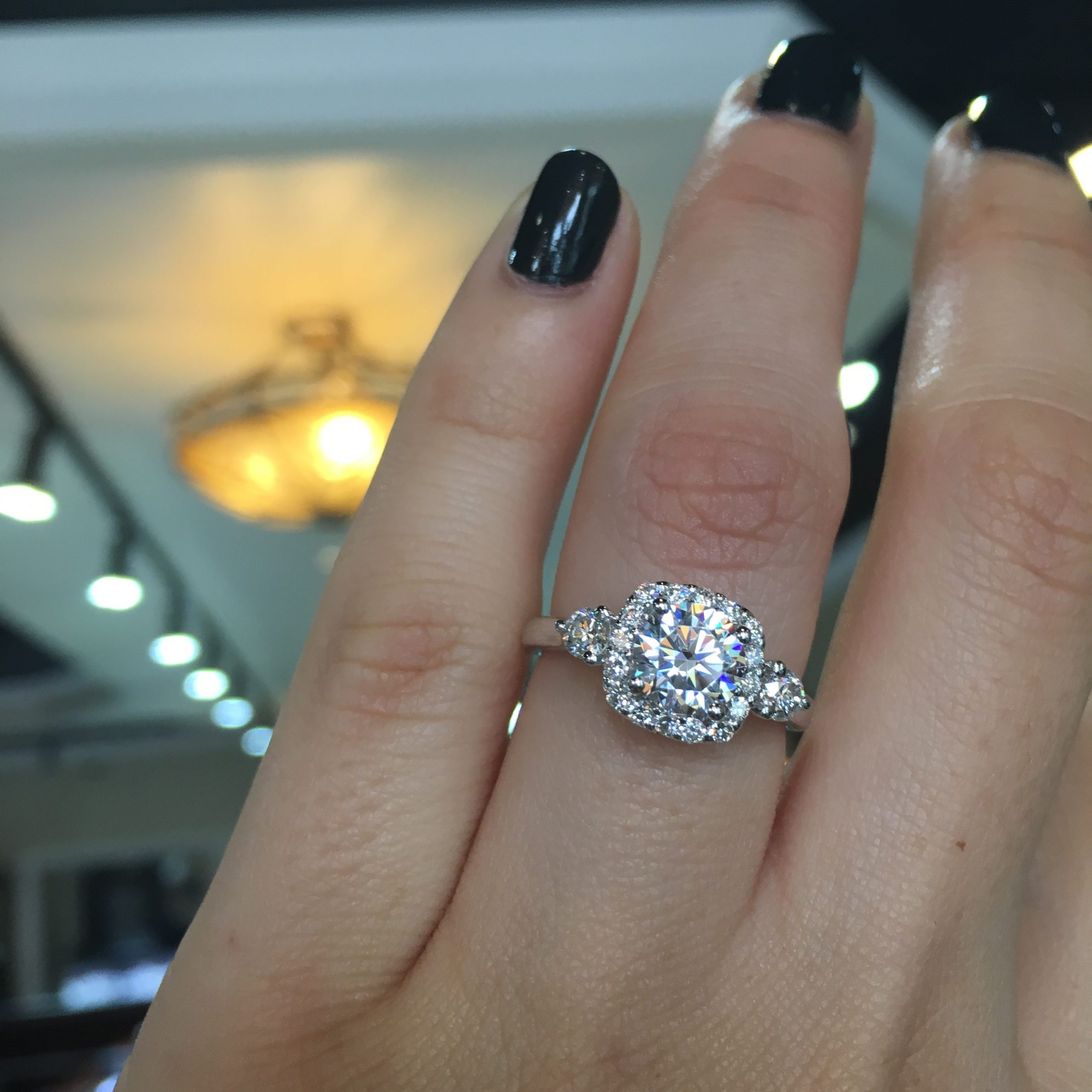 A stunning cushion halo enagement ring under $4000
