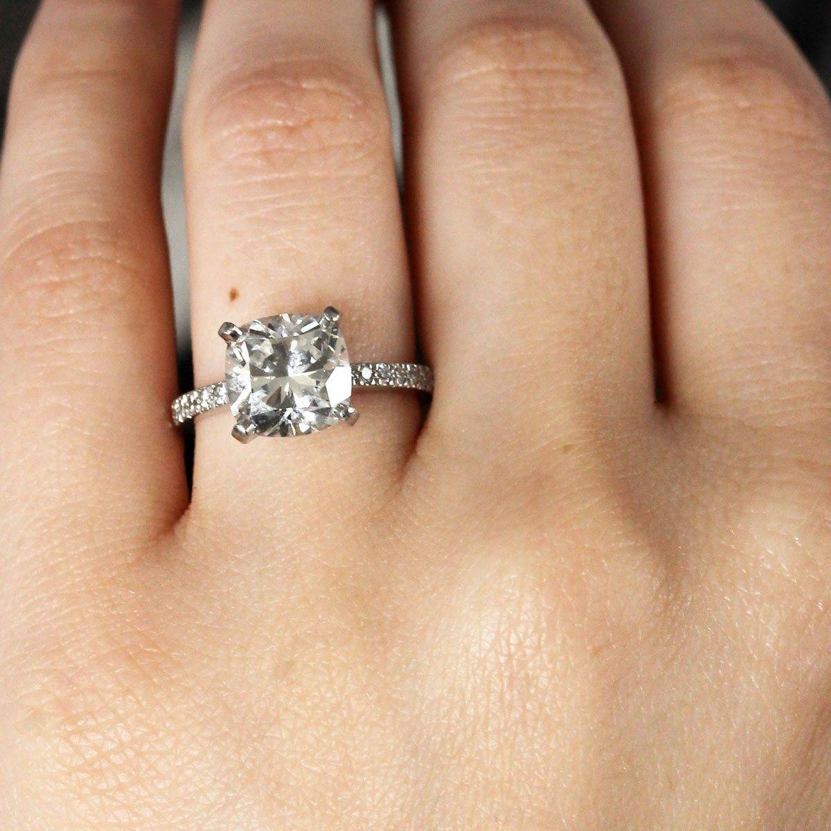 It's hard to believe, but this 3 carat cushion cut Tiffany engagement ring is an estate jewelry piece too! And is $10,000 less than retail because of it.