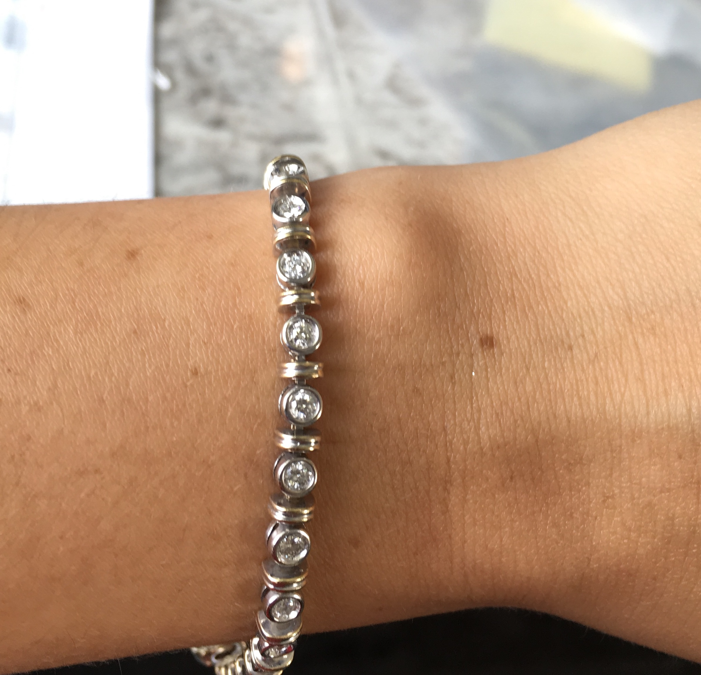diamond tennis bracelet in white gold and yellow gold