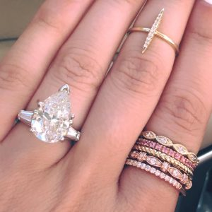 How does shape affect engagement ring cost