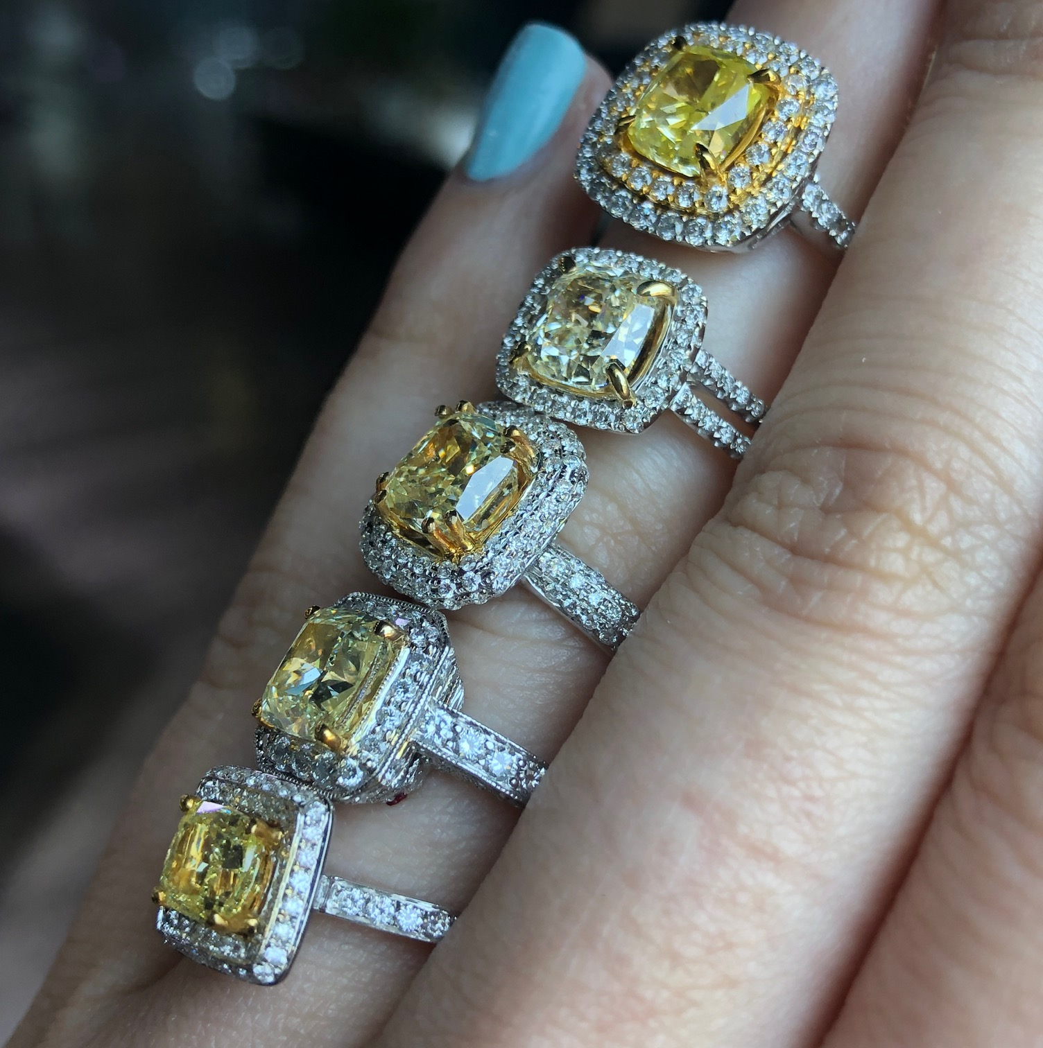 side view of 5 yellow diamond engagement rings