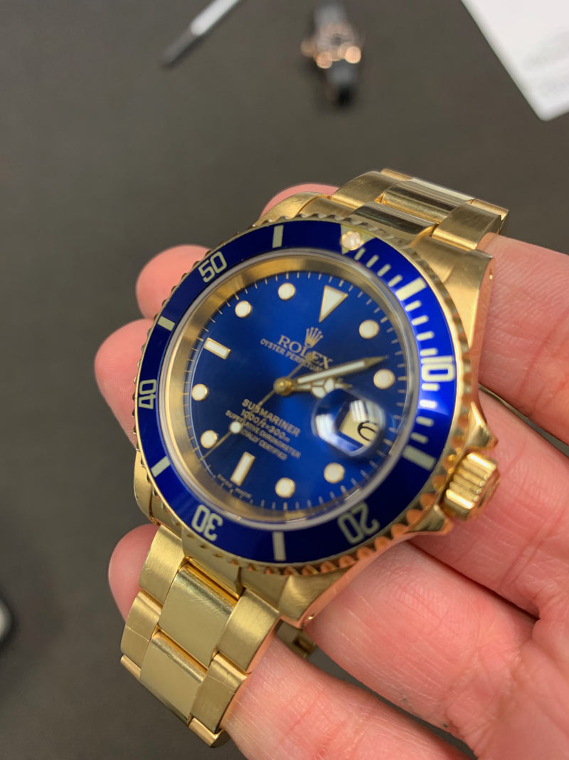 rolex submariner yellow gold blue dial review