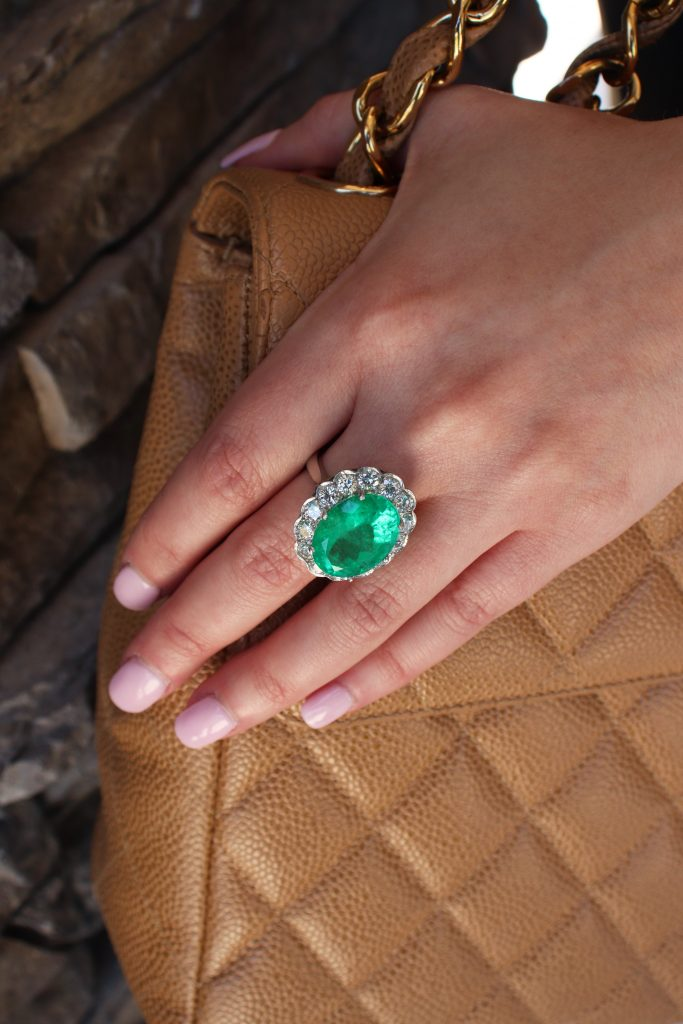 emerald ring with diamonds and chanel bag