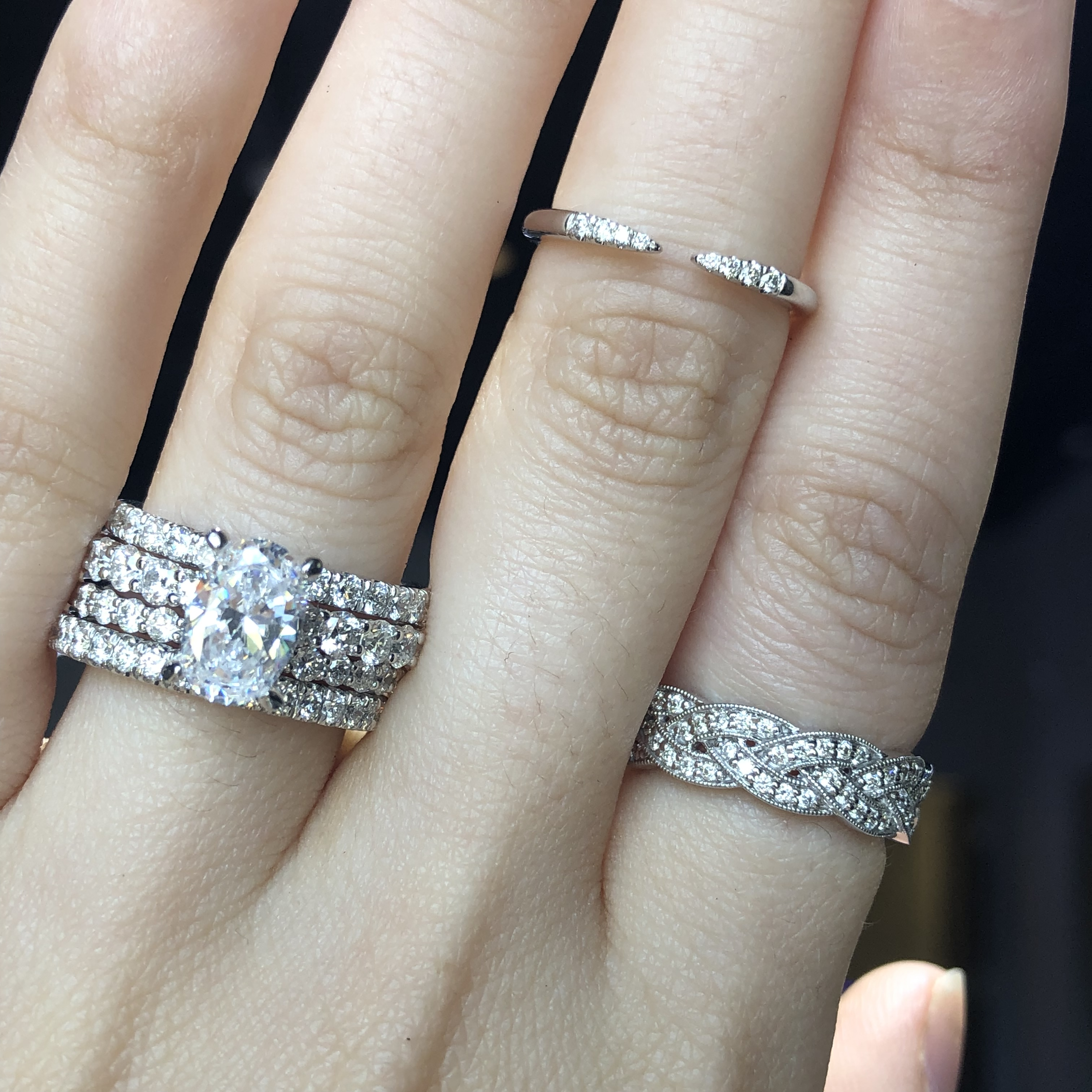 white gold and diamond wedding ring stacks on left hand