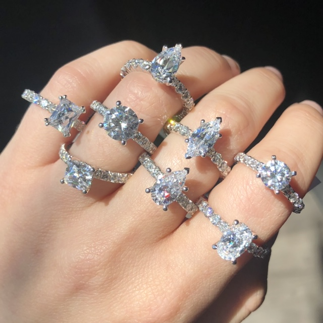 how much to spend on an engagement ring look at several rings with diamond bands