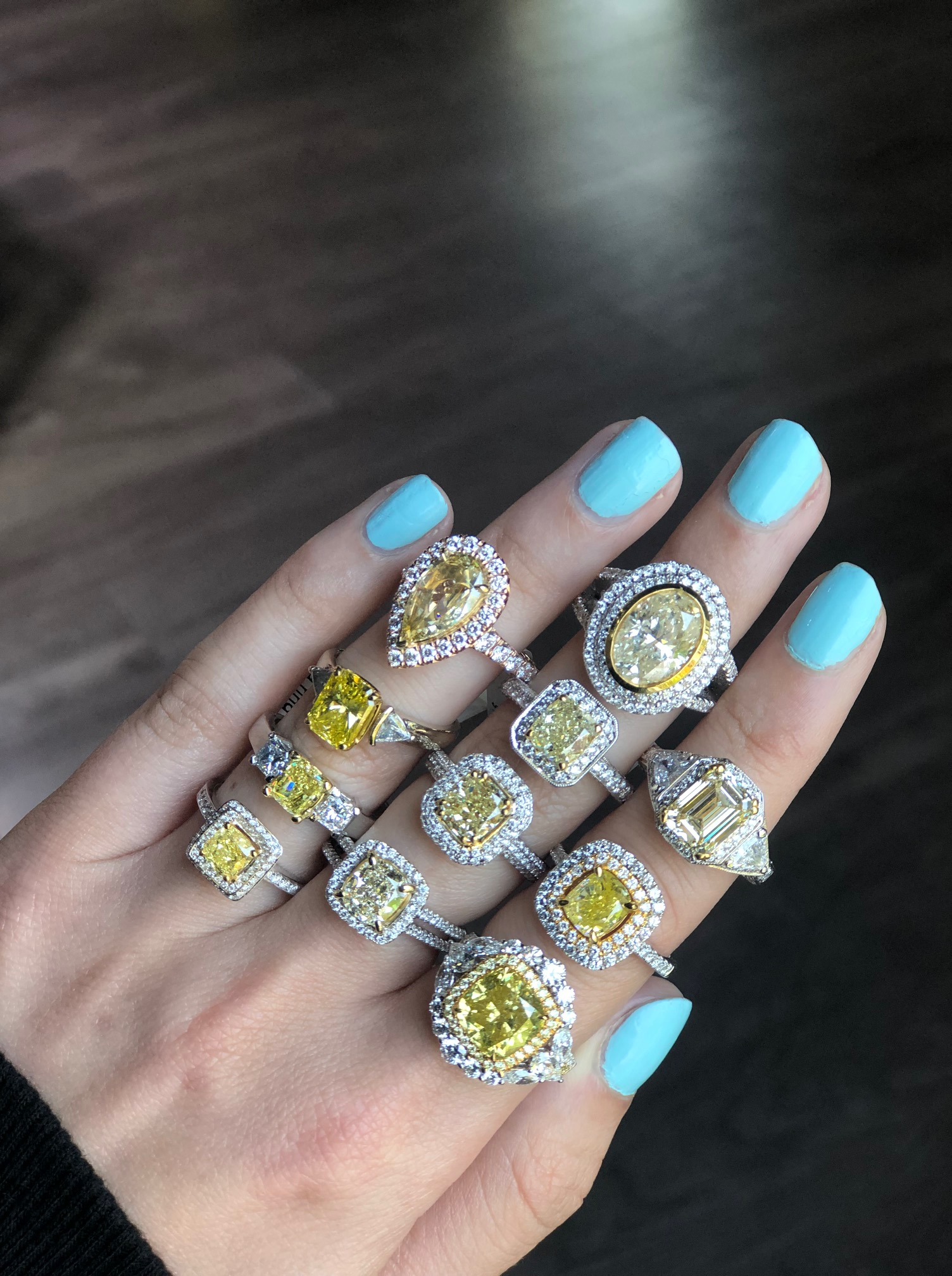 several yellow diamond engagement rings with halo to figure out how much to spend on an engagement ring