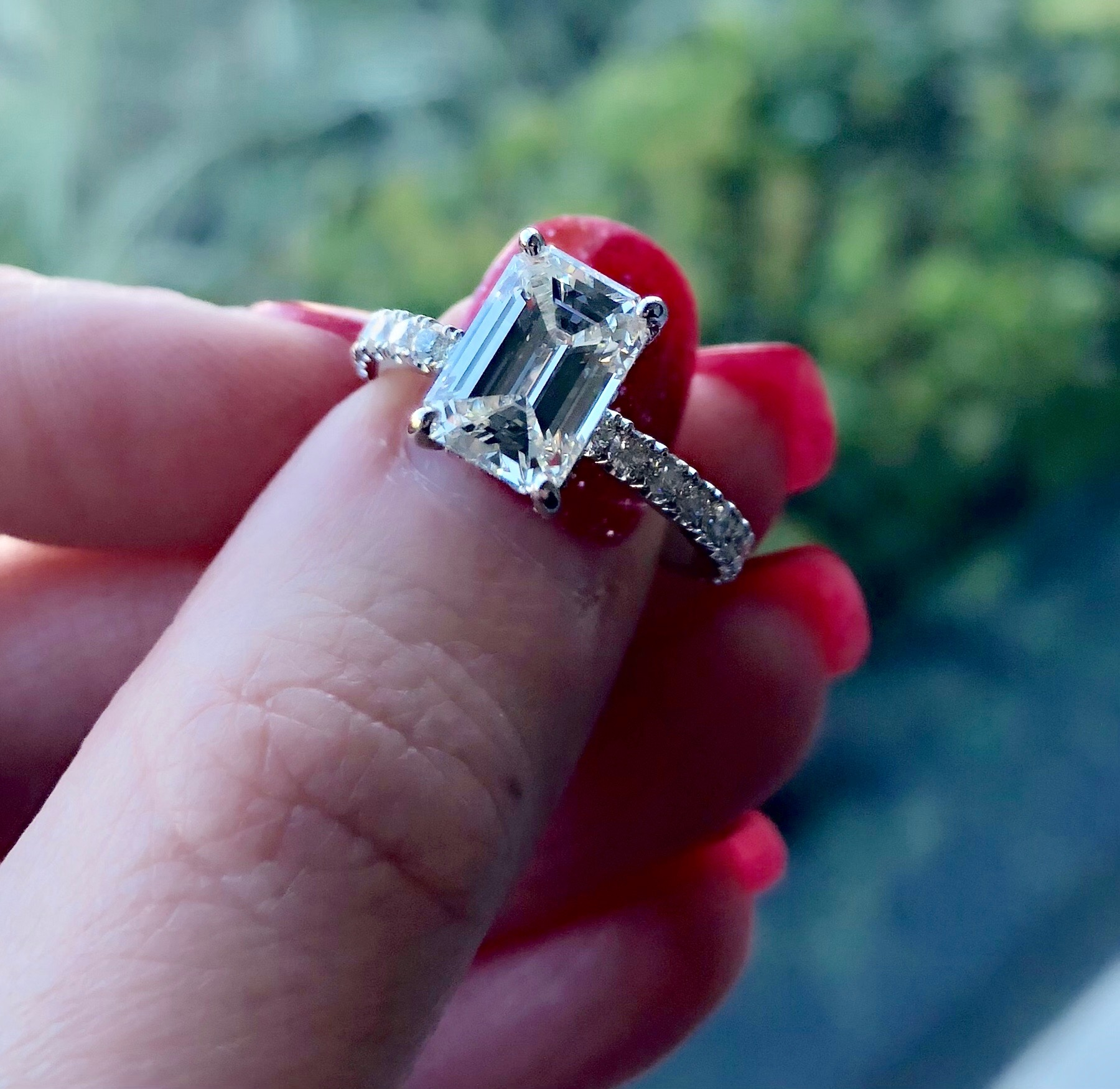 emerald cut engagement ring with accent diamond band